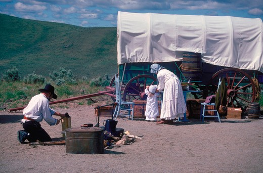 Stock Photo: 4286-53110 Actors portray early American settlers traveling by covered wagon at the Interpretive Center, Oregon Trail, Oregon.