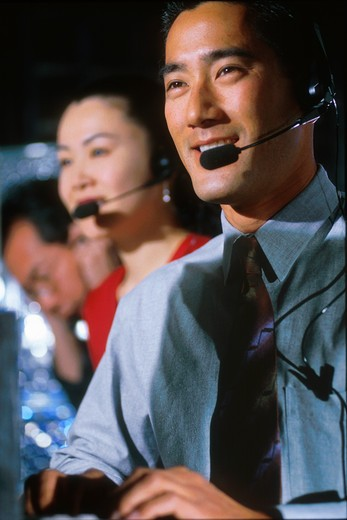 Stock Photo: 4286-53341 Telephone operators wearing headsets.