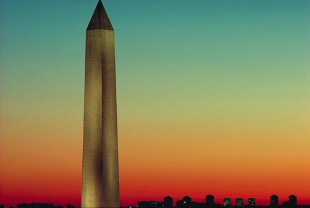 Stock Photo: 4286-53519 The Washington Monument rises above the Washington, DC skyline at sunset.