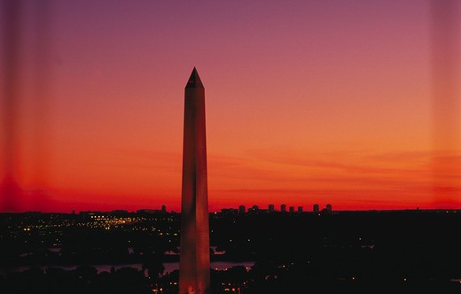 The Washington Monument rises above the Washington, DC skyline at sunset. : Stock Photo