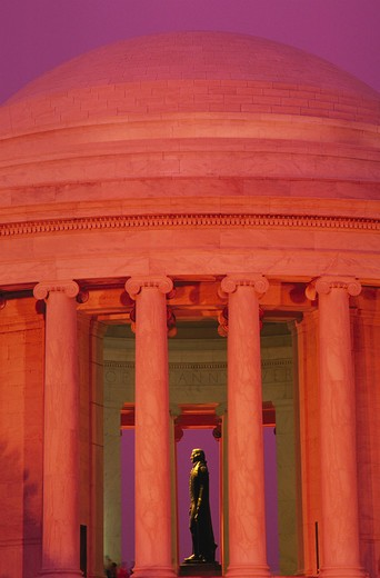 Statue of Thomas Jefferson seen through columns surrounding the Jefferson Memorial, Washington, DC. : Stock Photo