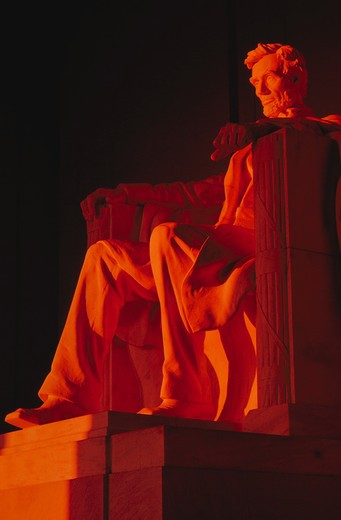 Statue of Abraham Lincoln inside the Lincoln Memorial at sunset, Washington, DC. : Stock Photo