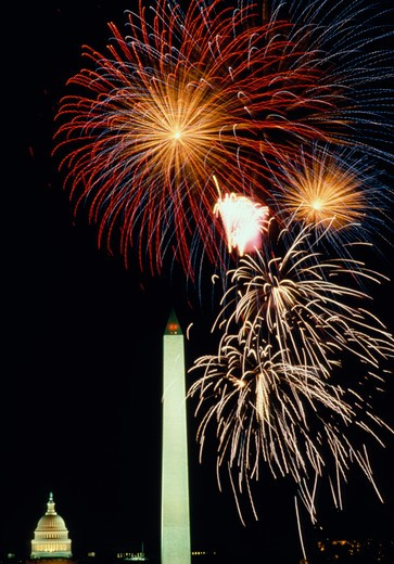 Stock Photo: 4286-54770 July 4th fireworks over the U.S. Capitol and Washington Monument in Washington, DC.