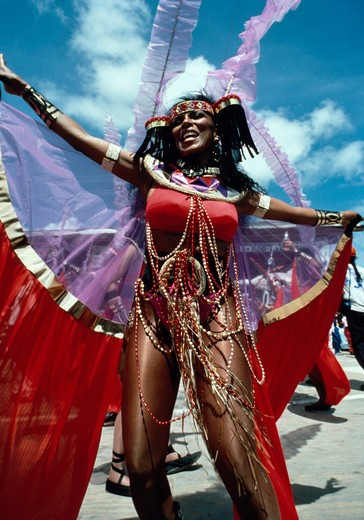 Dancer in elaborate costume performs on reviewing stage during annual Mardi Gras carnival in Port of Spain, Trinidad. : Stock Photo