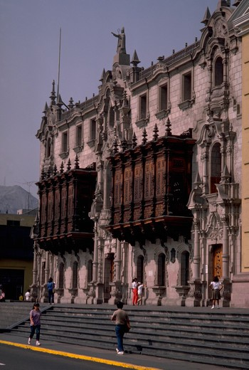 Stock Photo: 4286-54863 Colonial wooden balconies are attached to the front of the Archbishop?s Palace in the Plaza de Armas, Lima, Peru.