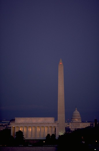 View at dusk of the Lincoln Memorial, the Washington, Monument, and the United States Capitol dome (left to right) in Washington, DC. : Stock Photo