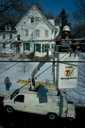 Stock Photo: 4286-54915 Line Technician Larry Price checks cable TV connections from bucket for Cable TV Montgomery in Rockville, Maryland.