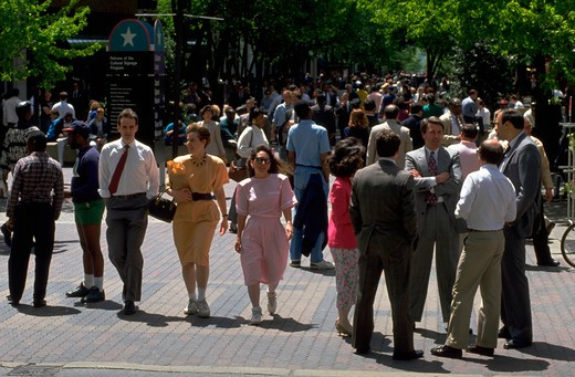 Pedestrians stroll at noon on sunny day on the Market Street Mall in downtown Wilmington, Delaware. : Stock Photo