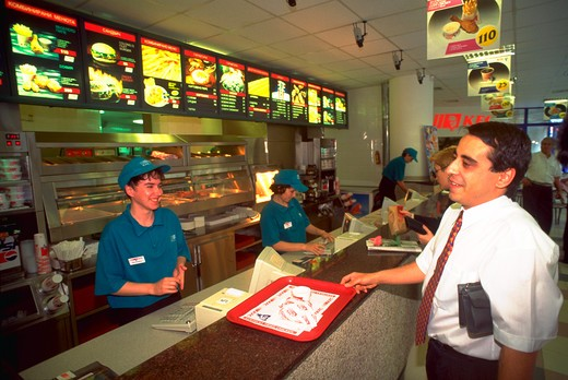 Stock Photo: 4286-55019 Customer and employee at Kentucky Fried Chicken restaurant in Sofia, Bulgaria.