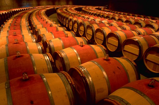 Rows of french oak barrels for aging wine at Opus One Winery, Napa Valley, California. : Stock Photo