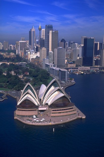 Stock Photo: 4286-55052 Aerial view of Sydney Opera House and the downtown Sydney skyline, Sydney, Australia. Sydney is the site of the 2000 Olympic Games.