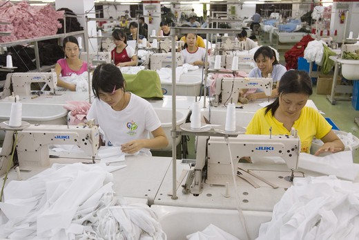 SHENZHEN, GUANGDONG PROVINCE, CHINA - Workers in a garment factory in city of Shenzhen, one of mainland China's first Special Economic Zones, SEZ. : Stock Photo