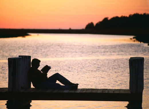 Stock Photo: 4286-56339 Person reading on a pier
