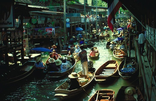 Stock Photo: 4286-56439 View of tourists and venders crowded on boats at a floating market in Thailand.