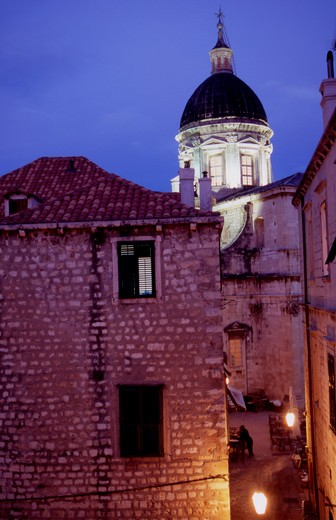 Illuminated alleyway and Cathedral Dome at night.Dubrovnik Old Town. Croatia. : Stock Photo