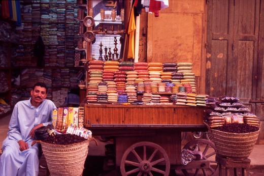 Stock Photo: 4286-56692 Egypt. Luxor. Herb and tea trader sat outside his shop.