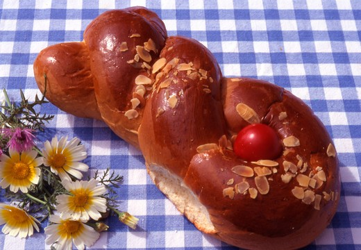 Stock Photo: 4286-56710 Greece. Traditional Easter Bread (Tsoureki) on blue and white checkerboard tablecloth.