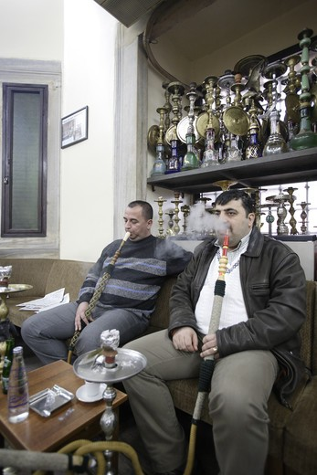 Stock Photo: 4286-57236 Two Turkish men smoking their Nargile (Bubble Pipe)  Corlulu Ali Pasha traditional cafe. Istanbul, Turkey. MR and Property Released