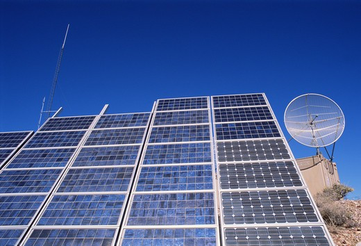 Stock Photo: 4286-57281 View of communication and solar panels on a day with very blue skies.