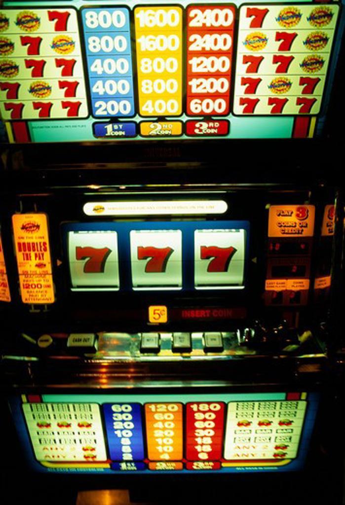 Hitting the jackpot: slot machine showing three 7?s, Princess Beach Casino, Curacao. : Stock Photo