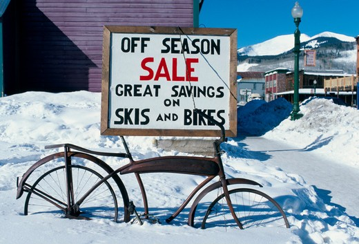 Stock Photo: 4286-57693 Store sign for skis and bikes  covered by snow in Crested Butte, CO.
