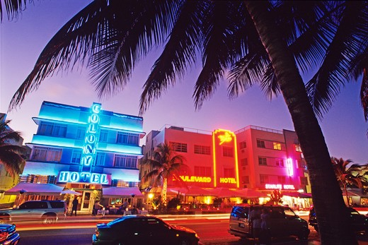 Stock Photo: 4286-58036 Glowing neon accents art deco era hotels along Ocean Drive at twilight, Miami Beach, Florida