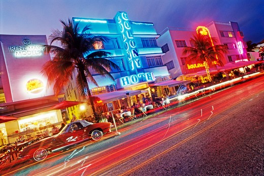 Stock Photo: 4286-58037 Glowing neon accents art deco era hotels along Ocean Drive at twilight, Miami Beach, Florida