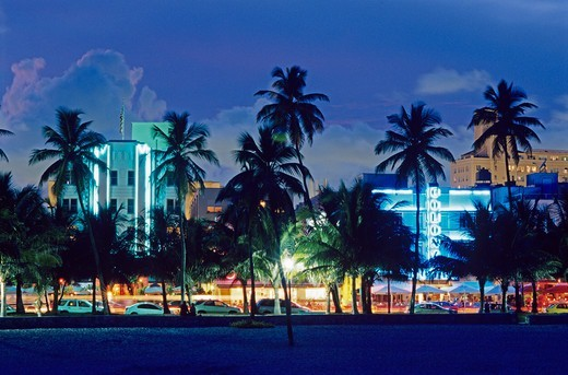 Stock Photo: 4286-58051 Glowing neon accents art deco era hotels along Ocean Drive at twilight, Miami Beach, Florida