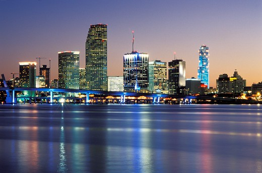 Stock Photo: 4286-58067 Christmas season snow flakes light downtown Miami, FL, office tower along Biscayne Bay at sunset.