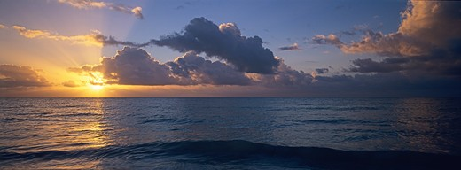 Rising sun breaks through offshore clouds in the Florida Keys, Bahia Honda State Park, Florida. : Stock Photo
