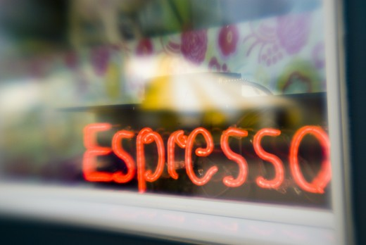Stock Photo: 4286-58239 Soft focus lens captures neon sign glowing through cafe window, Otter Tail, Minnesotta.