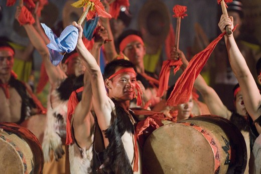 Sani ethnic minority drummers, wearing traditional Charwa or sheepskin vests, at stadium performance that culminates the annual June Torch Festival, Shilin, Yunnan Province, China. : Stock Photo