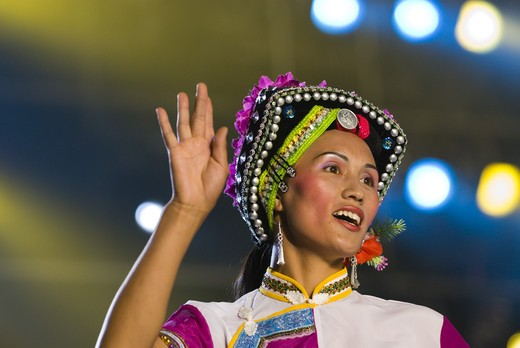 Stock Photo: 4286-58281 Performer depicts folk stories of Sani ethnic minority at stadium performance culminiting the annual June Torch Festival, Shilin, Yunnan Province, China.
