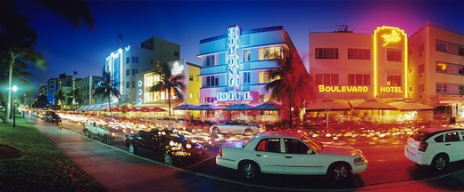 Glowing neon accents art deco era hotels along Ocean Drive at twilight, Miami Beach, Florida. : Stock Photo