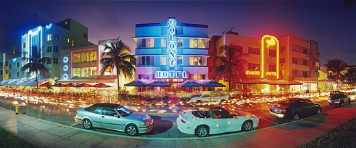 Stock Photo: 4286-58357 Glowing neon accents art deco era hotels along Ocean Drive at twilight, Miami Beach, Florida.