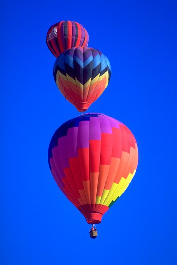 Colorful hot air balloons against a blue sky background at the Albuquerque Balloon Festival in Albuquerque, New Mexico. : Stock Photo