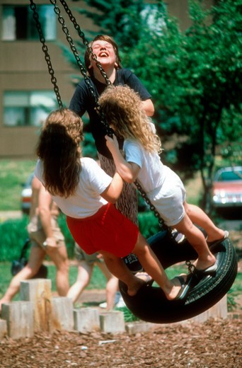 Kids play on swing. : Stock Photo