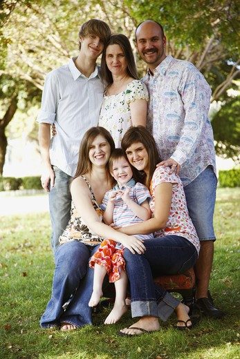 Stock Photo: 4286-60084 Portrait of a couple with their son and daughters in a lawn