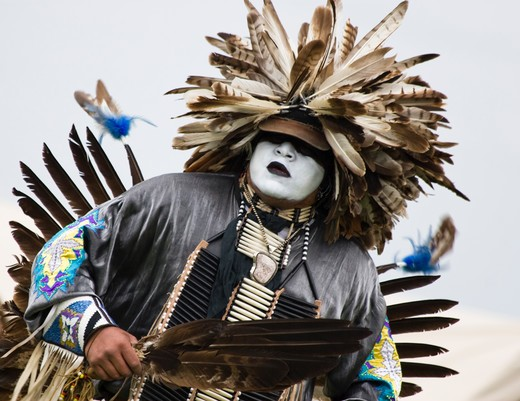Stock Photo: 4286-60215 Charles Hankinson (Eagle Tail), a Native American from the Micmac tribe of Canada, dances in full traditional regalia at the Healing Horse Spirit PowWow. His face paint was giftedŒ to him by his grandfather. NOT MODEL RELEASED. EDITORIAL USE ONLY.