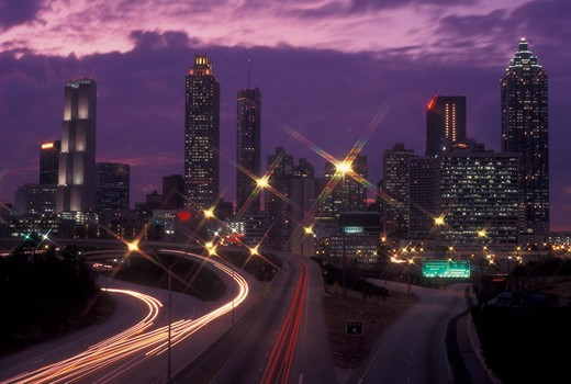 Stock Photo: 4286-60388 Atlanta, GA, Georgia, Downtown skyline, Freedom Parkway, evening, streaks of car lights along the expressway, road, transportation, traffic