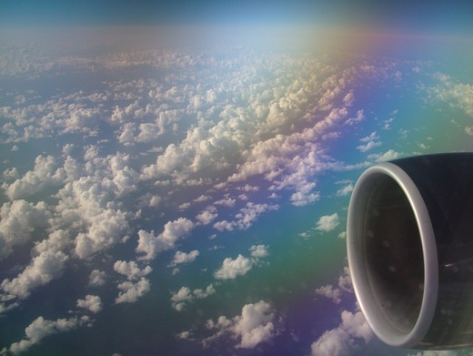 Aerial, airplane flying over the Pacific Ocean, clouds : Stock Photo
