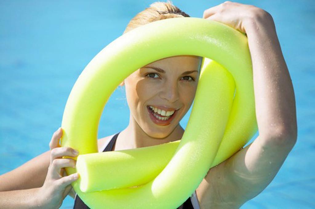 Stock Photo: 4286-61457 young woman doing aquaaerobic in the swimmingpool