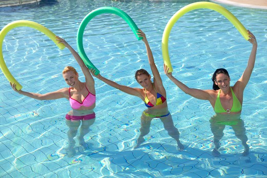 Stock Photo: 4286-61458 three woman doing aquaaerobic in the swimmingpool