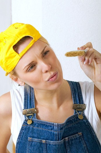 Stock Photo: 4286-61610 woman craftwoman renovating her appartement