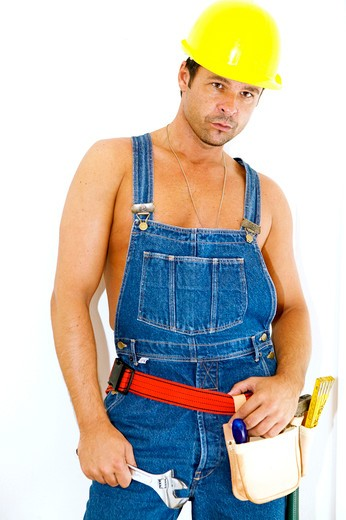 workman with hardhat wrench : Stock Photo
