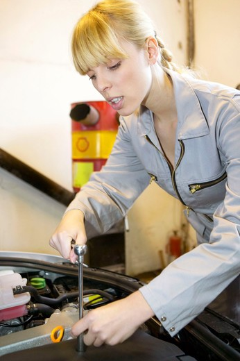 Stock Photo: 4286-61643 young female motor mechanic at a garage