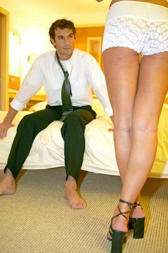 Stock Photo: 4286-62007 Woman seducing a man in a hotel