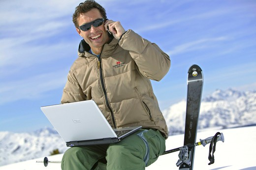 Stock Photo: 4286-62370 man with notebook and mobile at winter holiday