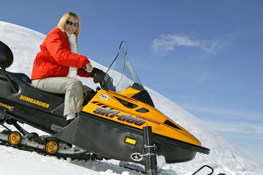 Woman on Ski Scooter Winter Holiday : Stock Photo