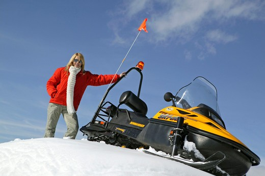 Stock Photo: 4286-62436 Woman on Ski Scooter Winter Holiday